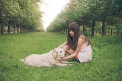 Girl plays with dog Stock Photography