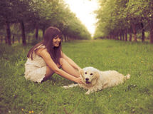 Girl plays with dog Stock Images