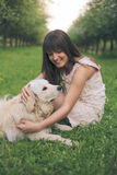 Girl plays with dog Royalty Free Stock Image