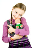 Girl plays with a doll royalty free stock photos