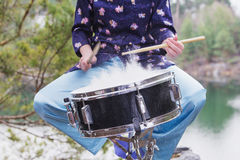 Girl plays the drum outdoors. Stock Images