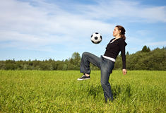 The girl plays football Stock Images