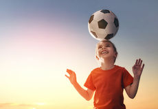 Girl plays football. Stock Images