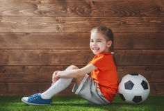 Girl plays football. Stock Photo