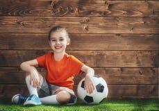 Girl plays football. Stock Image