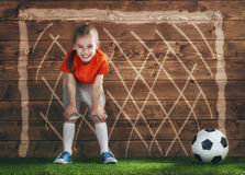 Girl plays football. Stock Image