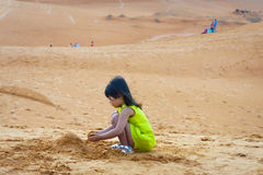 The girl plays fun on sand beach Royalty Free Stock Photos