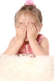 Girl plays with fur and closes his eyes with his hands Royalty Free Stock Images