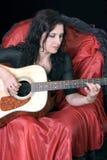 Girl plays a guitar Royalty Free Stock Photos