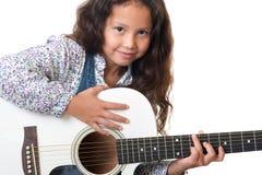 Girl plays the guitar stock photo