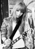 Girl plays guitar Stock Photos