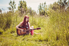 Girl plays the guitar Royalty Free Stock Photos