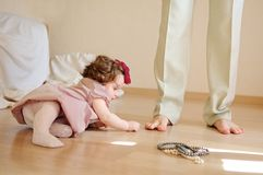 Girl plays with her father's foot Royalty Free Stock Images