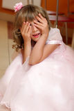 Girl plays hide-and-seek Stock Photo
