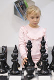 The girl plays interactive chess. In the center of entertaining science Stock Photos
