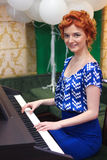 Girl plays keyboard musical instrument Royalty Free Stock Image