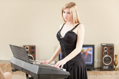 Girl plays keyboard synthesizer Royalty Free Stock Photos