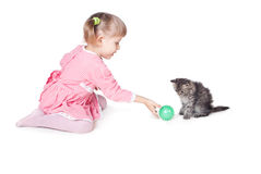 The girl plays with a kitten Royalty Free Stock Photos