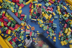 A girl plays in the large LEGO Stock Images
