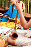 A girl plays a local Thai music instrument. Stock Images