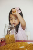 Girl plays macaroni stock photo
