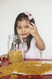 Girl plays macaroni stock photography