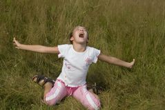 Girl plays on a meadow IV Royalty Free Stock Images
