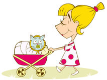 A girl plays in the mother. A girl carries a cat in a stroller Stock Image