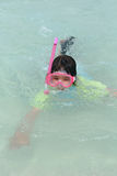 Girl plays in ocean. Girl plays in blue ocean water Royalty Free Stock Photo