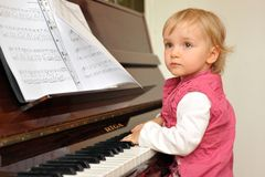Girl plays  piano Royalty Free Stock Photo