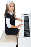 The girl plays the piano Royalty Free Stock Photos