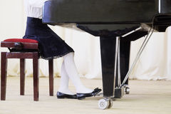 Girl plays the piano Stock Photo