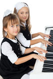The girl plays the piano Stock Photos