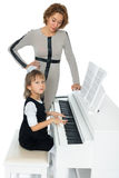 The girl plays the piano Royalty Free Stock Photo