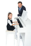 The girl plays the piano Royalty Free Stock Images