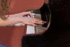 Girl plays piano Royalty Free Stock Image