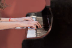 Girl plays piano Stock Photography