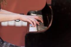 Girl plays piano Royalty Free Stock Photos