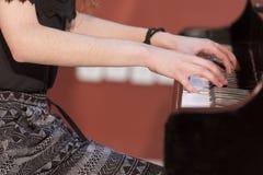 Girl plays piano Royalty Free Stock Photo