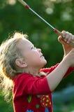 Girl plays with a racket Stock Photos