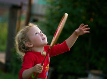 Girl plays with a racket in badminton Stock Photo