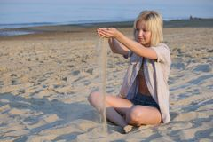 Girl plays sand. Stock Photography