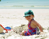 Girl plays on the sand. With the toys Royalty Free Stock Image