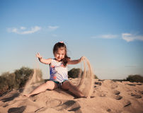 Girl plays by sand Royalty Free Stock Photos