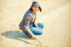 Girl plays on the sea beach Stock Photography