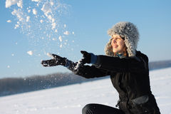Girl plays with a snow Royalty Free Stock Photography