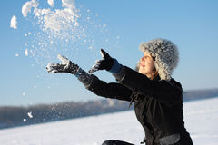 Girl plays with a snow Stock Images