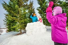 Girl plays snowball game with her friends Royalty Free Stock Images
