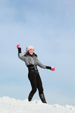 Girl plays snowballs in winter Stock Images