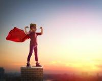 Girl plays superhero Stock Images